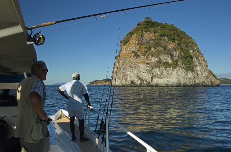 """""""K"""" is for knoll and a kindly sea, Sugarloaf Rock in water calmer than a teacup. High mountains inland shield this region of northwestern Madagascar from trade winds and most stormy weather."""